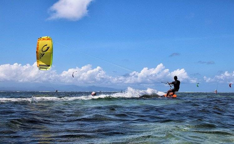 Kitesurfing is a water sport that too involves a board but it is attached to a kite which is very huge and resembles a parachute