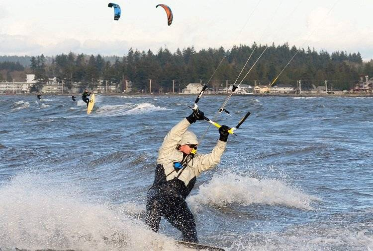 Group Of People Kitesurfing At Winter