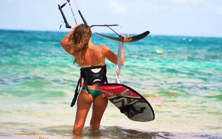 girl with kiteboarding equipment