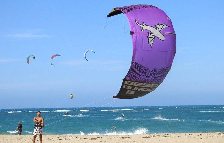 young man launches kite