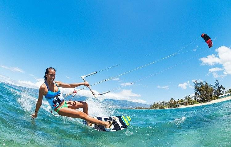 young girl enjoy kitesurfing in ideal weather