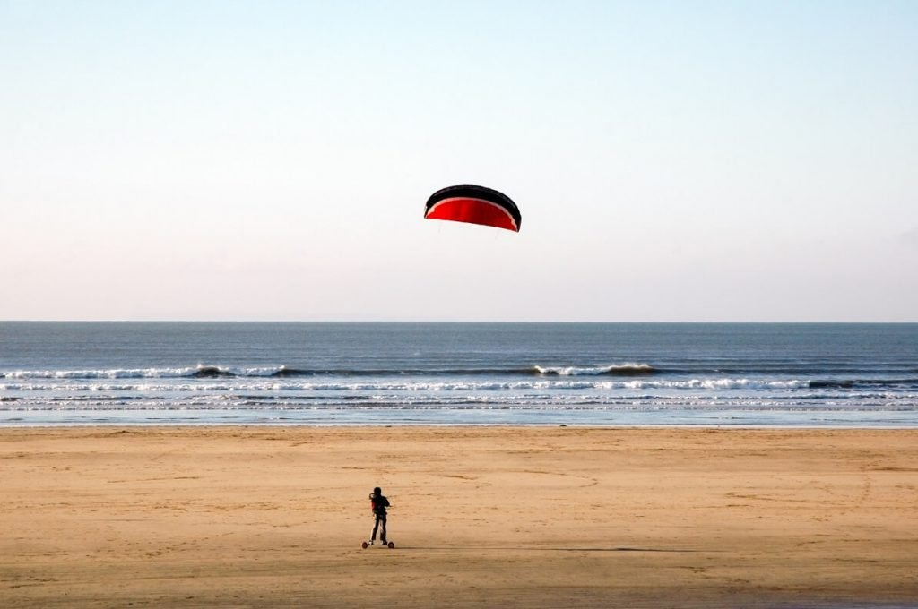 Kite landboarding on a beach