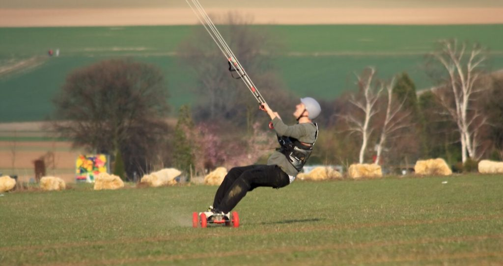 Kite landboarding on grass