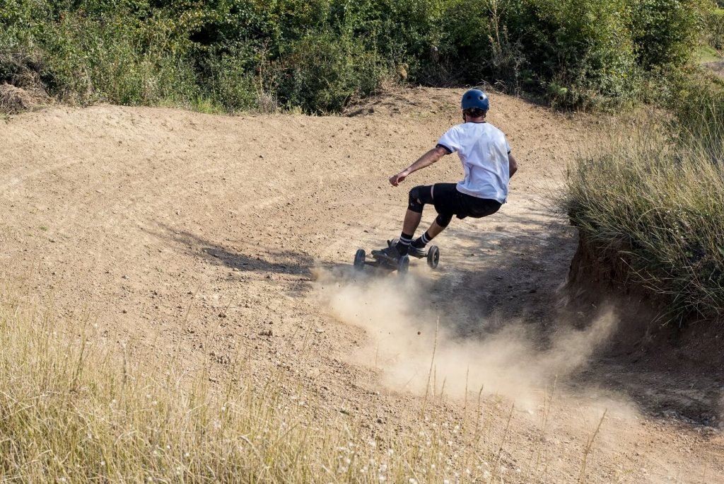 Mountainboard rider during downhill in mountainboard park